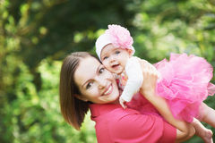 Happpy mother holding her baby girl Stock Image