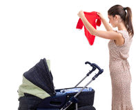 Young mother with baby pram Stock Images