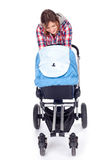 Young mother with baby pram. (stroller), white background Royalty Free Stock Image