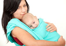Young mother with baby in sling Stock Photography
