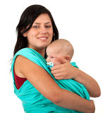 Young mother with baby in sling Stock Images