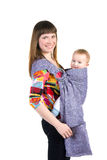 Young mother with baby in sling Stock Photo