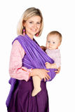 Young mother with baby in sling isolated white Royalty Free Stock Photography