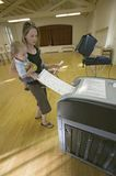 Young mother and Baby (Sophia Larson) inserts completed ballot for Congressional election, November 2006, into an electronic scann Royalty Free Stock Photo