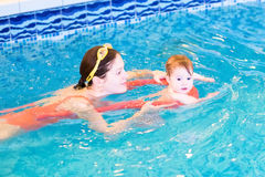 Young mother with baby in the swimming pool. Young mother with a little baby in the swimming pool Stock Photography
