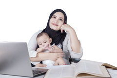 Young mother and baby thinking idea Stock Photo