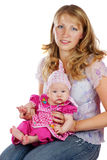 Young mother and babygirl. Smiling young mother holding her babygirl both looking at camera isolated in white Royalty Free Stock Images