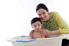 Young mother bathing cheerful baby. Against white,close up royalty free stock photos