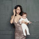 Young mother with beautiful little baby in her arms royalty free stock photos