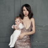 Young mother with beautiful little baby in her arms royalty free stock photo