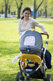 Young mother with a carriage Stock Photography