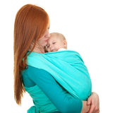 Young mother carrying baby boy in sling Royalty Free Stock Photo
