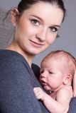 Young mother carrying infant Royalty Free Stock Photo