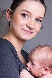 Young mother carrying infant Stock Photography