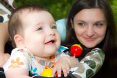 Young mother with a charming baby Royalty Free Stock Images