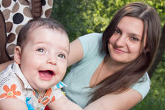 Young mother with a charming baby Stock Photos
