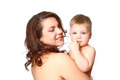 Young mother with a charming baby on white background Royalty Free Stock Image