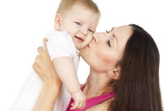 Young mother with a child. Young mother kissing baby isolated Royalty Free Stock Photos