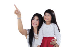 Young mother and child looking at copy space Royalty Free Stock Photos
