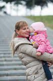 Young mother with child outside. Royalty Free Stock Photos