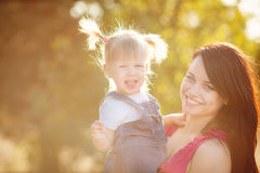 Young mother with child outside on a summer day royalty free stock image