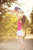 Young mother with child outside on a summer day Royalty Free Stock Photography
