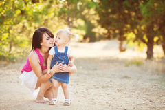 Young mother with child outside on a summer day Royalty Free Stock Photos