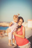 Young mother with child outside on a summer day Royalty Free Stock Images