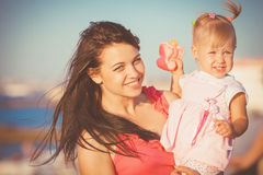 Young mother with child outside on a summer day Stock Photography