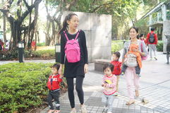 Young mother with a child in the tourist attraction in Shenzhen Royalty Free Stock Photo