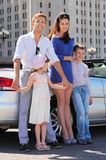 Young, mother and children stand near car Royalty Free Stock Image