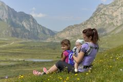Young mother with a children travels in the mountains royalty free stock images