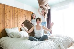Young mother and childs on morning yoga exercises in bed. A Young mother and childs on morning yoga exercises in bed Stock Photo