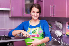 Young mother cook stock photo