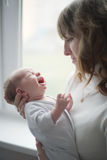 Young mother with crying baby Royalty Free Stock Photo