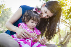 Young Mother and Cute Baby Girl Applying Fingernail Polish Royalty Free Stock Photo