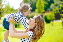 Young mother and cute daughter playing Stock Images