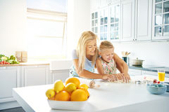 Young mother and daughter baking together Royalty Free Stock Images