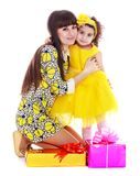 Young mother and daughter in a beautiful yellow Stock Photos