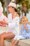 Young mother and daughter at a birthday party Stock Image