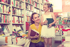 Young mother with daughter in book shop Stock Image
