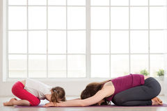 Young mother and daughter doing yoga exercise Stock Photography
