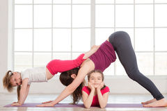 Young mother and daughter doing yoga exercise Royalty Free Stock Photography