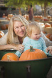 Young Mother and Daughter Enjoys the Pumpkin Patch Royalty Free Stock Images