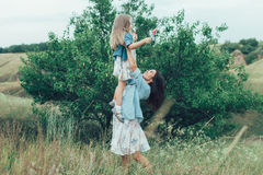 The young mother and daughter on green grass Royalty Free Stock Photography