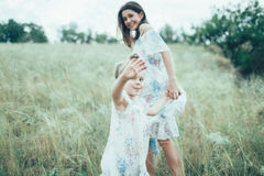 The young mother and daughter on green grass Royalty Free Stock Images