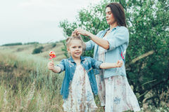 The young mother and daughter on green grass Stock Photography