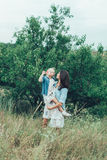 The young mother and daughter on green grass Royalty Free Stock Photos