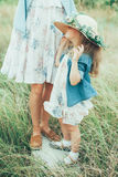 The young mother and daughter on green grass Royalty Free Stock Image