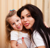 Young mother and daughter having fun at home Stock Images